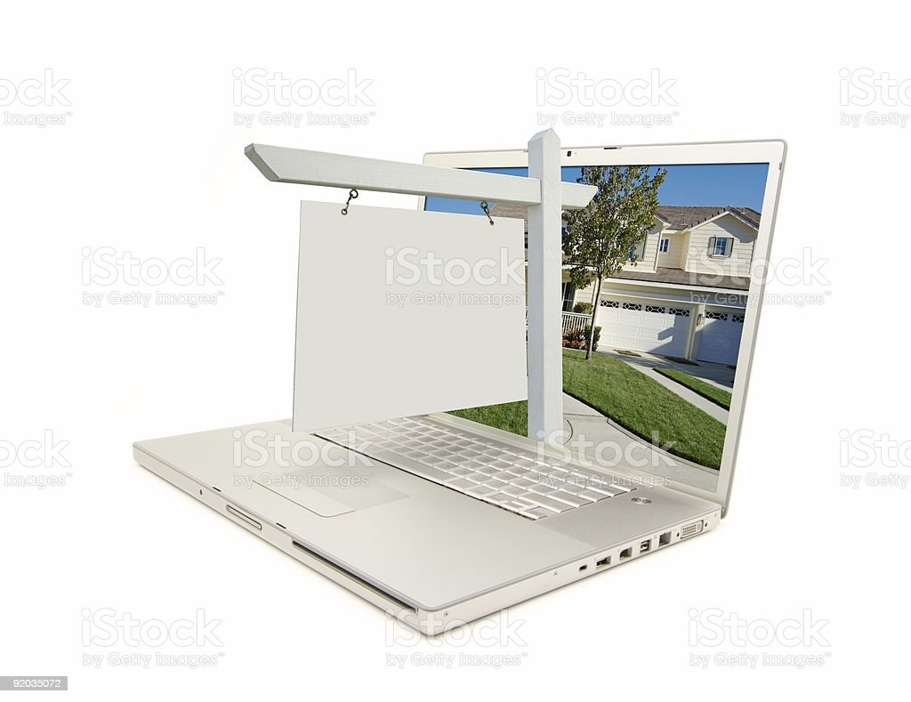 Blank Real Estate Sign and Laptop stock photo