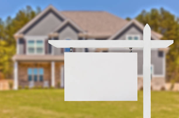 Blank Real Estate Sign in Front of Beautiful New House stock photo