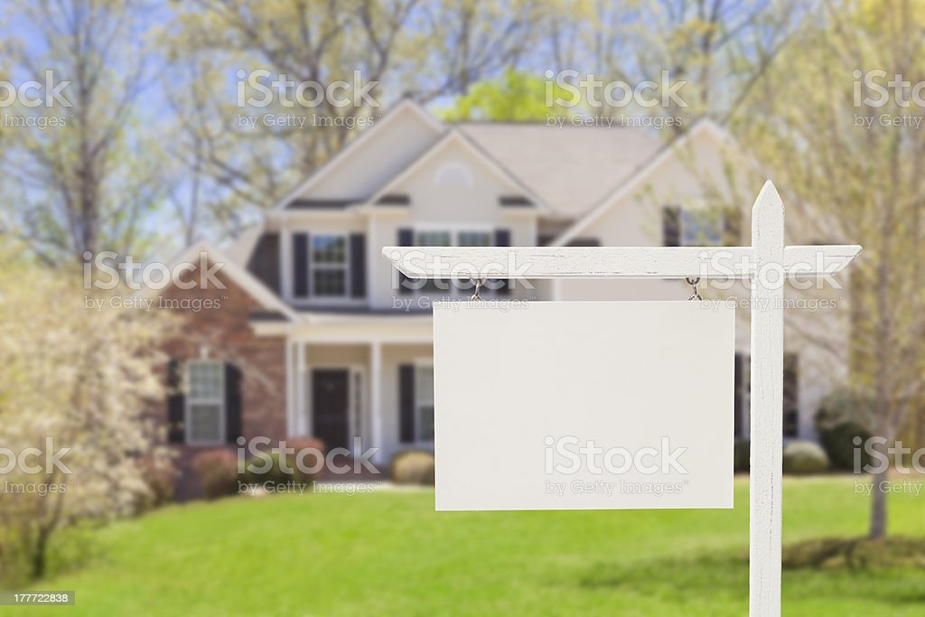 Blank Real Estate Sign in Front of New House stock photo