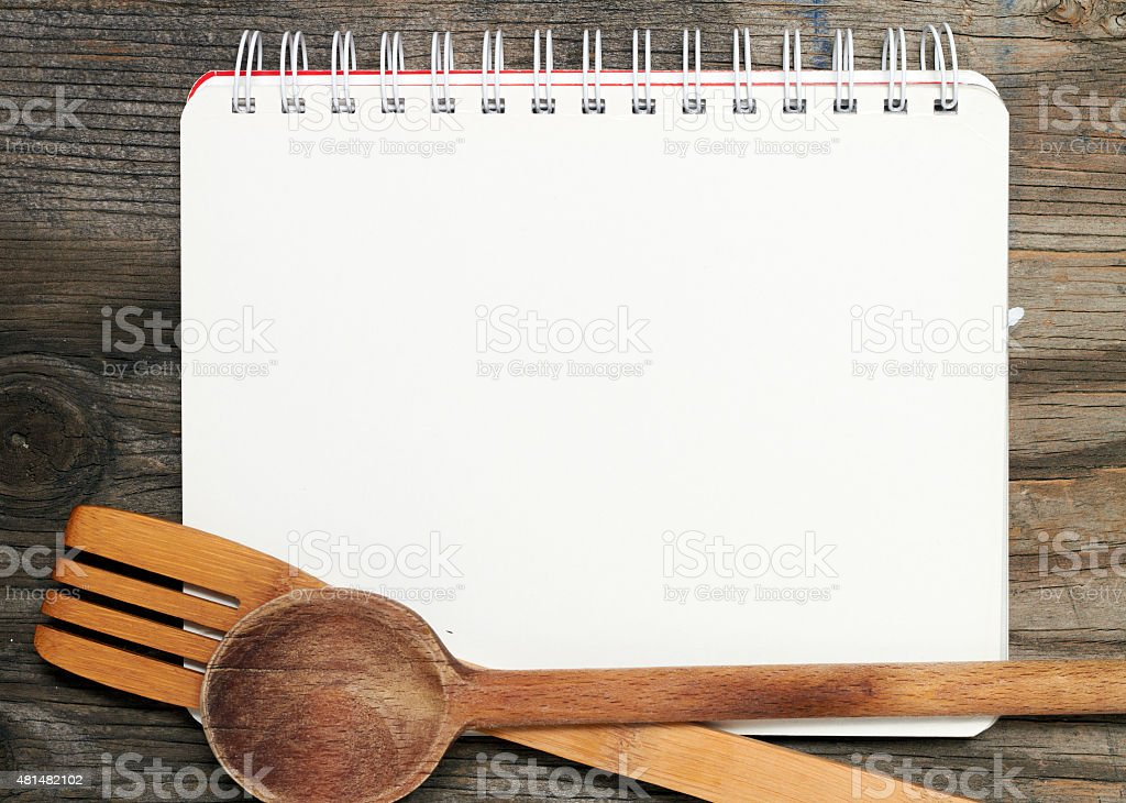 Blank recipe book on wooden table stock photo