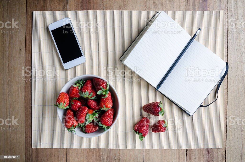 Blank recipe book with smartphone and strawberries royalty-free stock photo