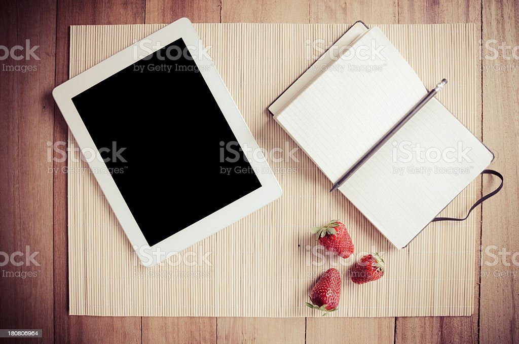 Blank recipe book with tablet and strawberries royalty-free stock photo