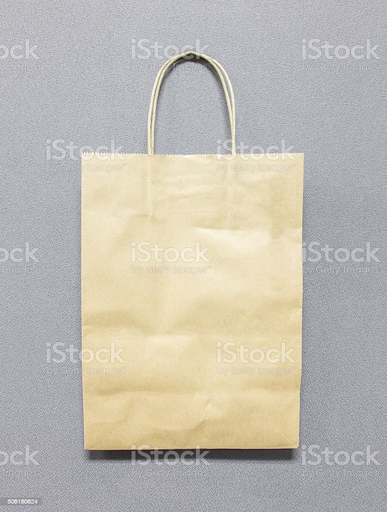 Blank Recycle Brown Paper Bag with Copy Space on Gray stock photo