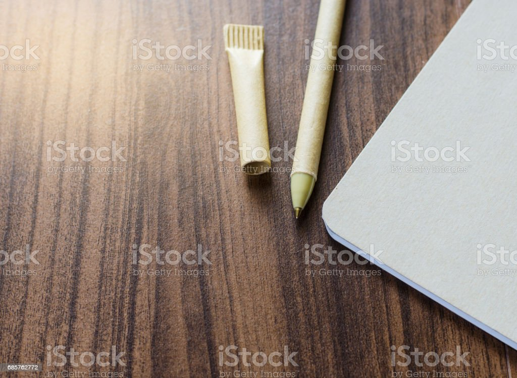 blank recycled notebook and pen on the wood table. zbiór zdjęć royalty-free