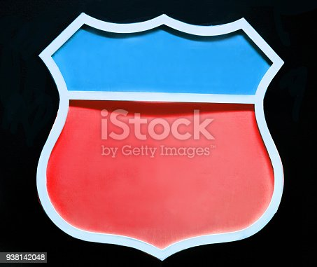 istock Blank red blue road sign close up isolated on black background. Vintage style. 3d illustration 938142048