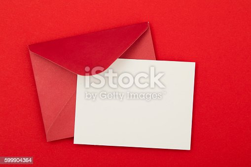 Blank invitation card with a red envelope on a red background