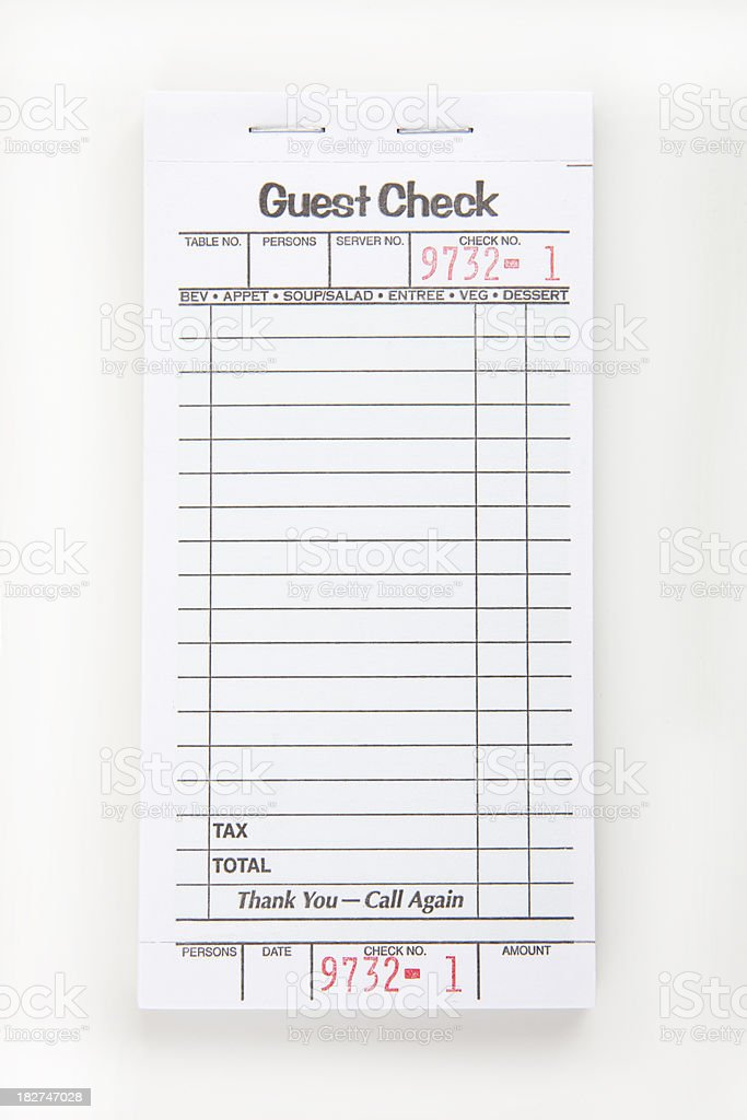 Blank check pad on a white table for a restaurant.