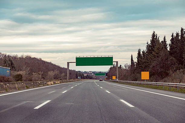 blank road destination sign on motorway - exit sign stock photos and pictures