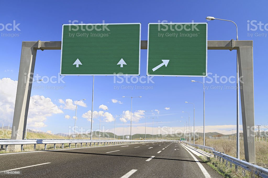 Blank road sign on highway stock photo
