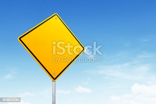istock Blank road sign with copy space over blue sky 928823260