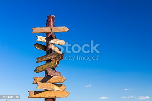 istock Blank road signs against blue sky. 492094246