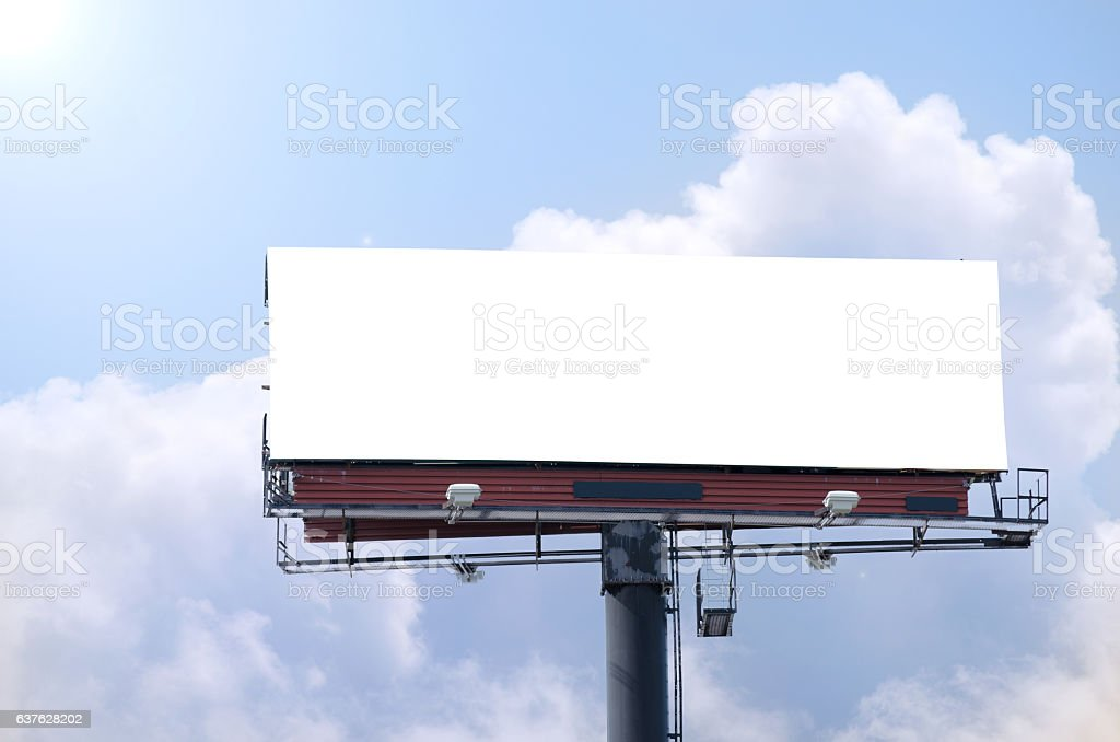 Blank roadside billboard on bright sunny blue sky day stock photo