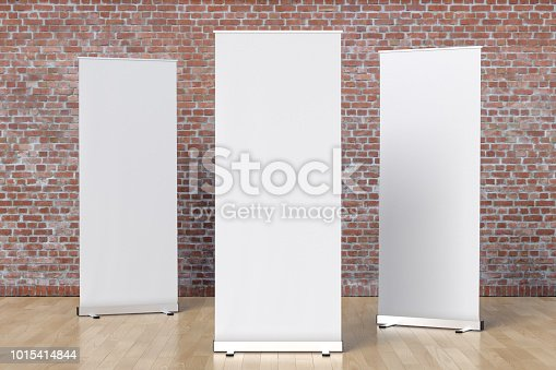 istock blank roll up banner display stands loft interior 1015414844
