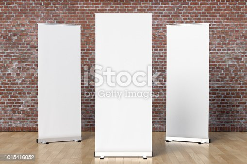 istock blank roll up banner display stands loft interior 1015416052