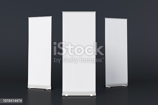 istock blank roll up banner display stands on black 1015414474