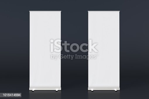 istock blank roll up banner display stands on black 1015414594