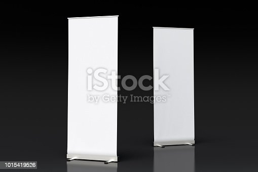 istock blank roll up banner display stands on black 1015419526