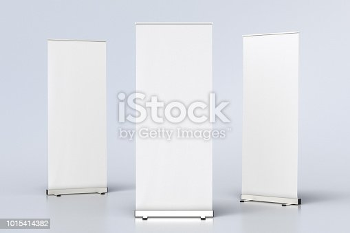 istock blank roll up banner display stands on white 1015414382