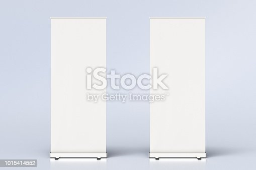 istock blank roll up banner display stands on white 1015414552