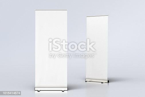 istock blank roll up banner display stands on white 1015414574