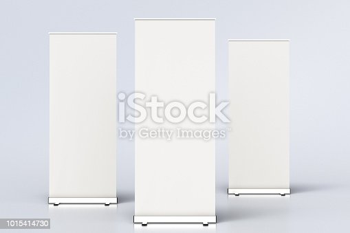 istock blank roll up banner display stands on white 1015414730