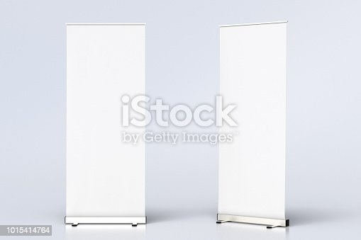 istock blank roll up banner display stands on white 1015414764