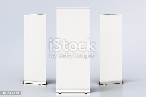 istock blank roll up banner display stands on white 1015419076