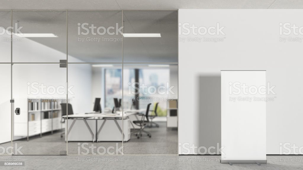 Blank roll up banner in modern office stock photo
