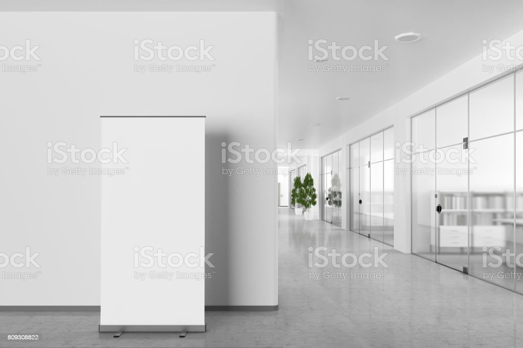 Blank roll up banner stand in modern office interior stock photo