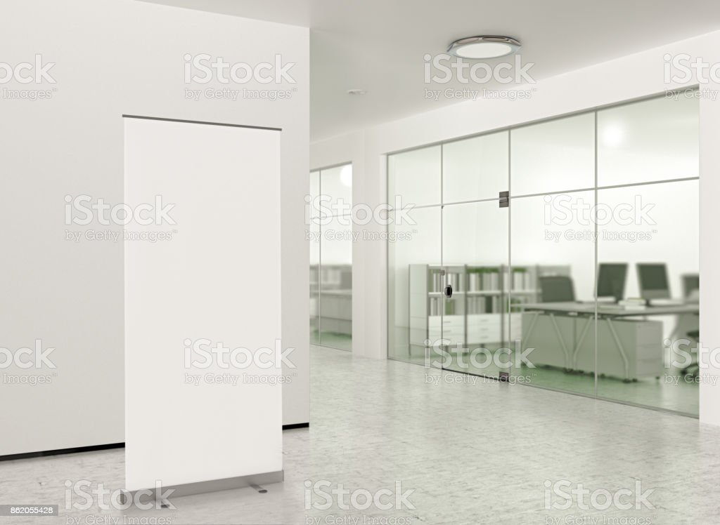 Blank roll up banner stand in modern office stock photo