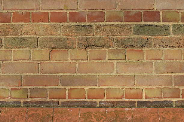 blank red / orange brick wall - whiteway graffiti stock photos and pictures