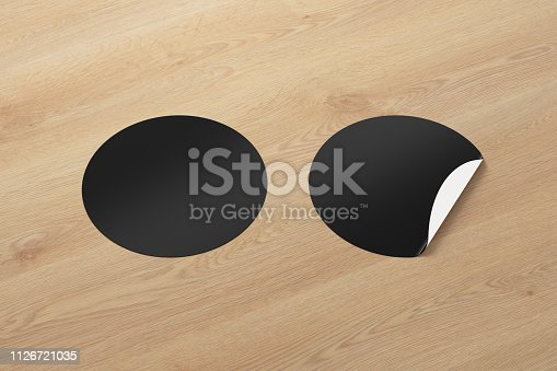 913812376 istock photo Blank  round stickers straightened and with folded corner 1126721035
