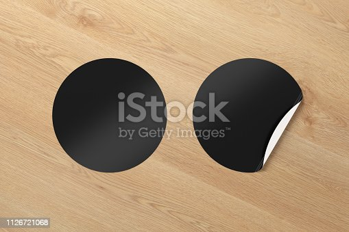 913812376 istock photo Blank  round stickers straightened and with folded corner 1126721068