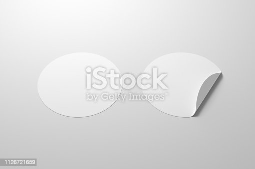istock Blank  round stickers straightened and with folded corner 1126721659