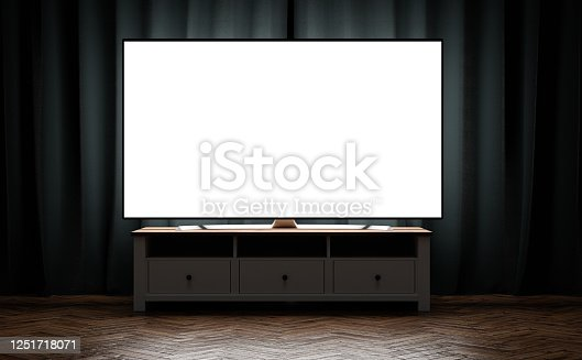 istock TV OLED blank screen at evening on tv stand on the background of blue curtains 1251718071