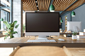 istock Blank Screen Computer On Table With Office In The Background 1266388738