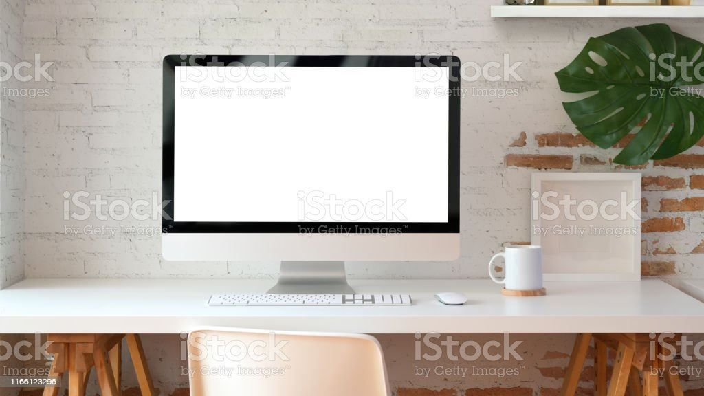 Blank screen desktop computer in minimal office room Blank screen desktop computer in minimal office room with decorations and copy space Backgrounds Stock Photo