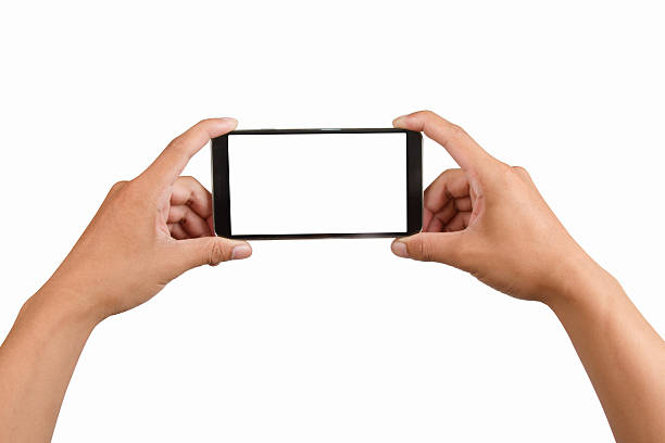 Blank screen mobile phone in hand. stock photo