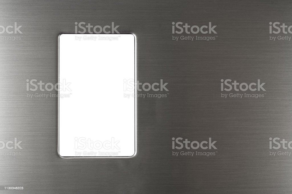 Blank screen on modern steel colored fridge or freezer. stock photo