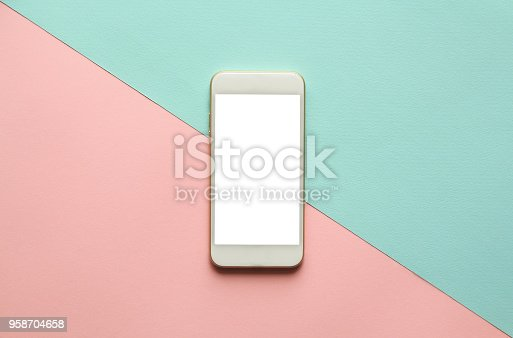Blank screen white cellphone on diagonal pastel pink and blue background. Minimal style, flatlay.