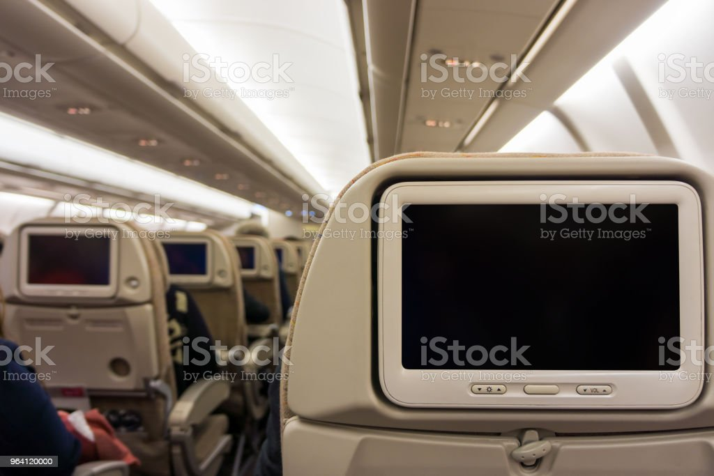 Blank screens display with black copy space on airplane seat monitors stock photo