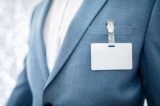 Blank security name tag on businessman suit pocket stock photo