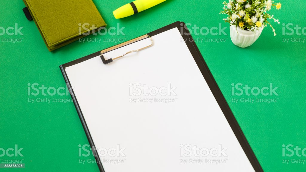 Blank sheet of paper for records, on a green background. Working notes. Copy space. Mockup stock photo