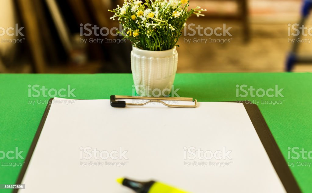 Blank sheet of paper for records, on a green table. Working notes. Copy space. Mockup stock photo