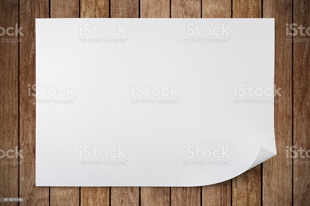 Blank sheet of paper on wood stock photo