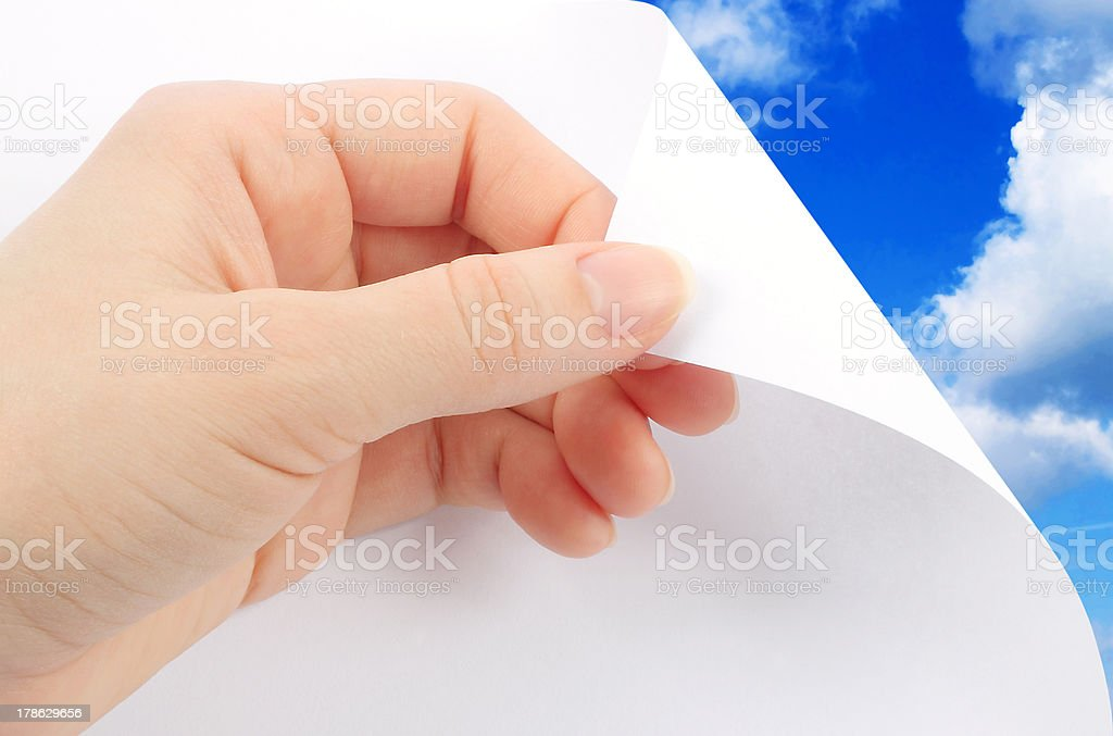 Blank sheet of paper with hand royalty-free stock photo