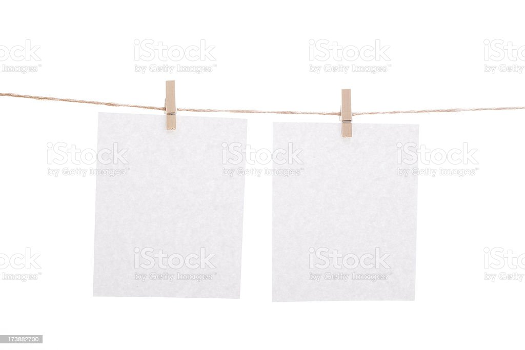 Blank sheet with clothespins royalty-free stock photo