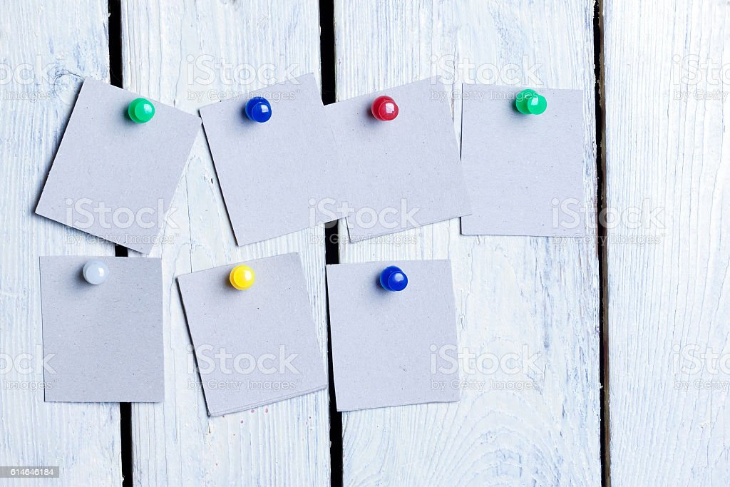 blank sheets of paper pinned colored buttons stock photo
