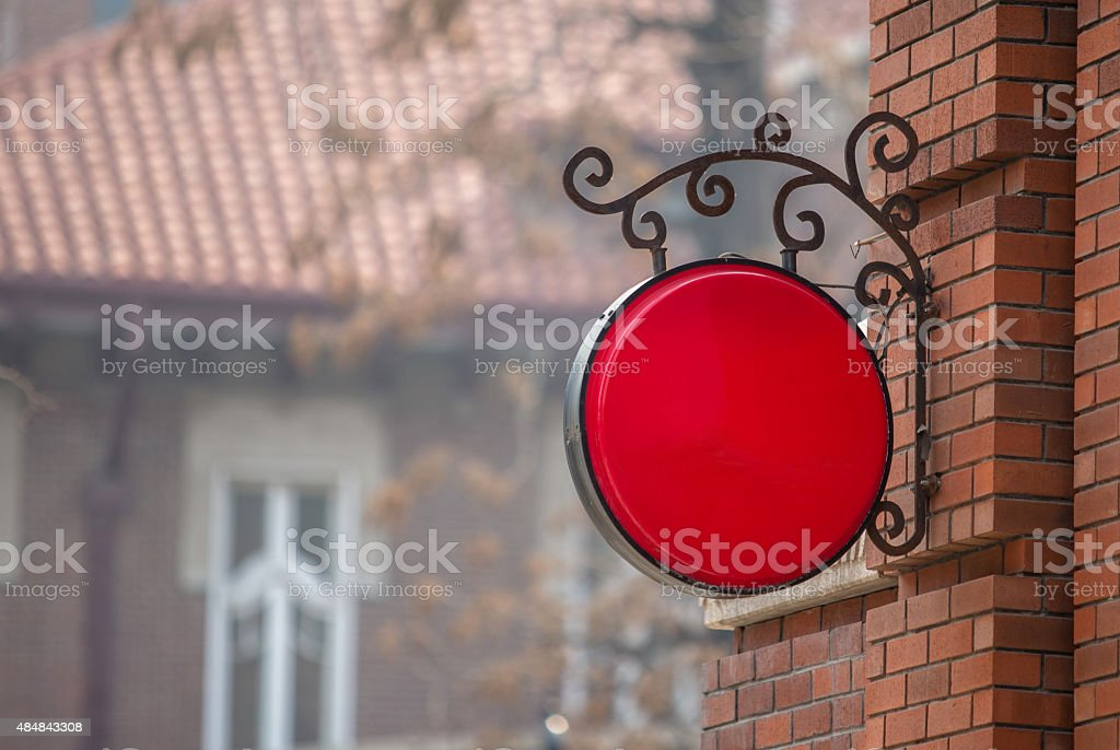 blank shop sign on the wall stock photo