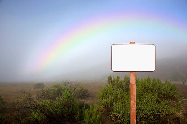 Blank Sign and Rainbow stock photo